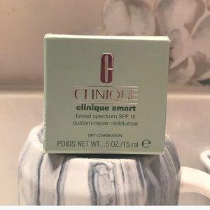 Clinique custom repair moisturizer. SPF 15.